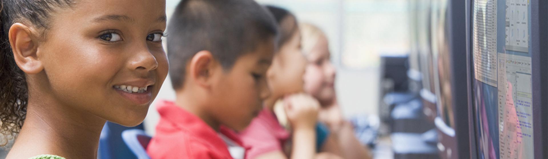 Year 4 primary school children working at computers