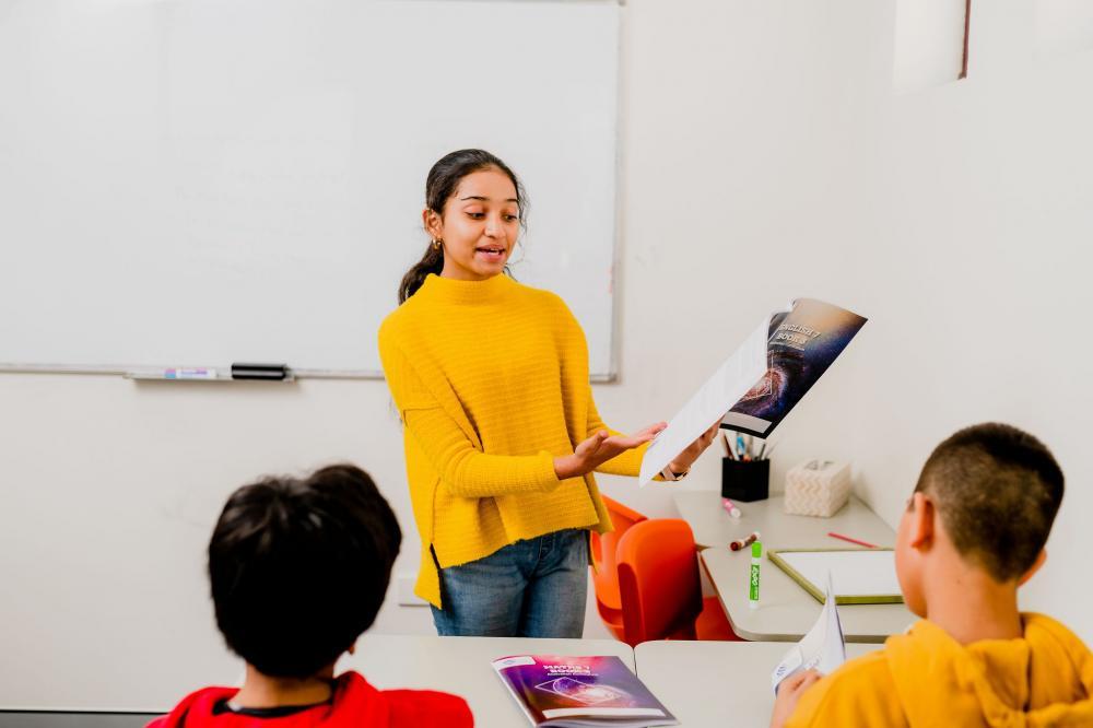Smiling student at her desk.